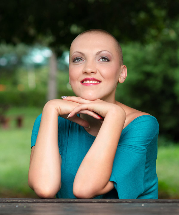 Image of woman with hair loss due to cancer