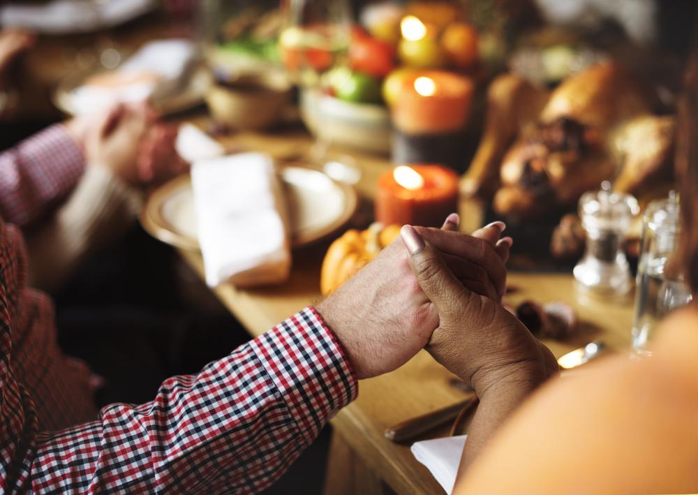 People Holding Hands Praying Thanksgiving Celebration